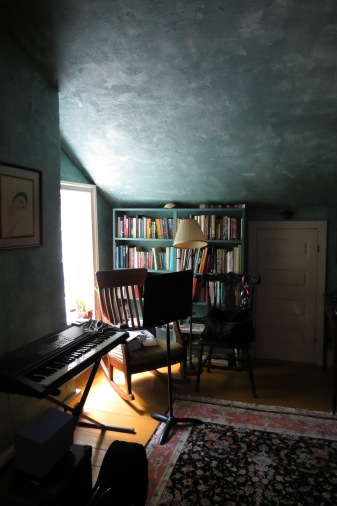 The music room above the kitchen has Vermeer-like light on the slanting ceiling.