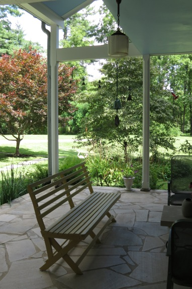 The pleasant flagstone patio beneath the sleeping porch.